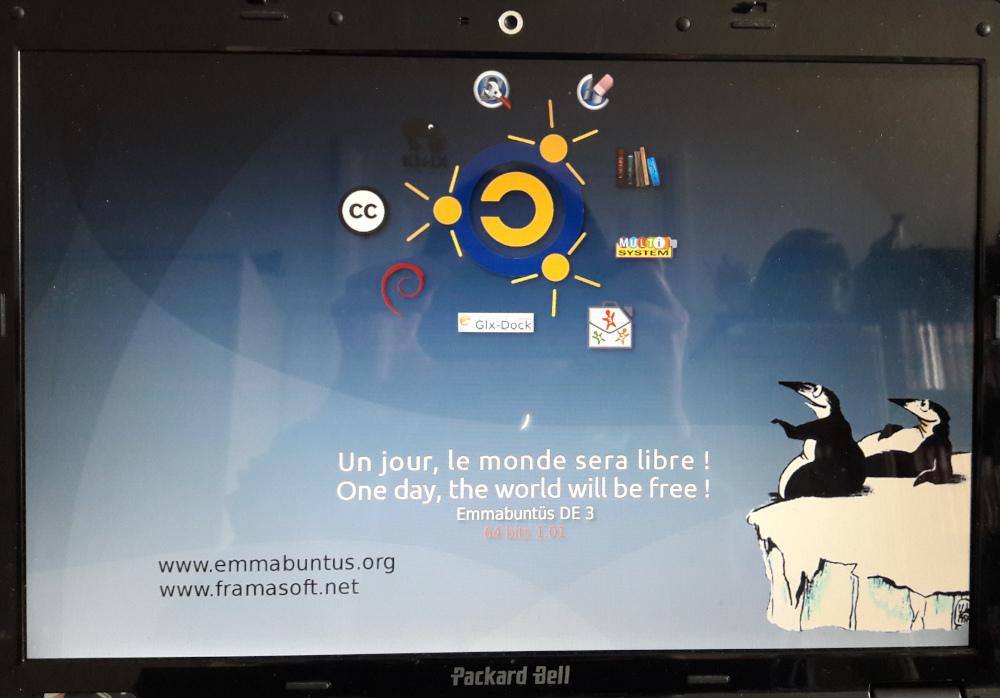 """écran démarrage emmabuntus de3 avec la phrase """"un jour, le monde sera libre !"""""""
