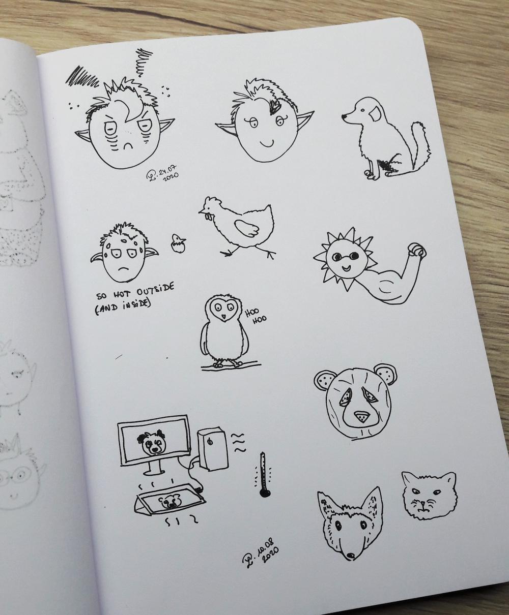 croquis d'animaux au stylo à encre sur un carnet aux pages blanches