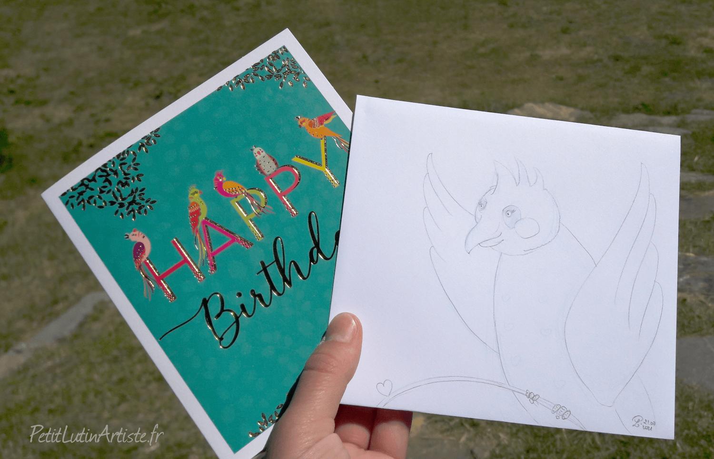 photo d'une carte postale avec des oiseaux. j'ai dessiné un oiseau sur l'enveloppe blanche