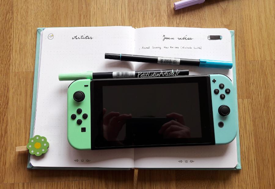 nintendo switch aux couleurs d'Animal Crossing New Horizons dans les mêmes tons que mes feutres bleu et vert pastels ainsi que mon carnet !